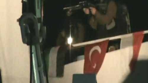 """A television grab made from the Turkish TV channel Cihan News Agency shows an Israeli commando member storming the """"Mavi Marmara"""" Turkish aid boat off the coast of the Gaza Strip."""