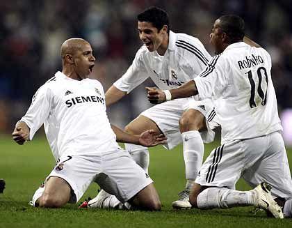"""Real Madrid players Roberto Carlos, """"Cicinho"""" and Robinho."""