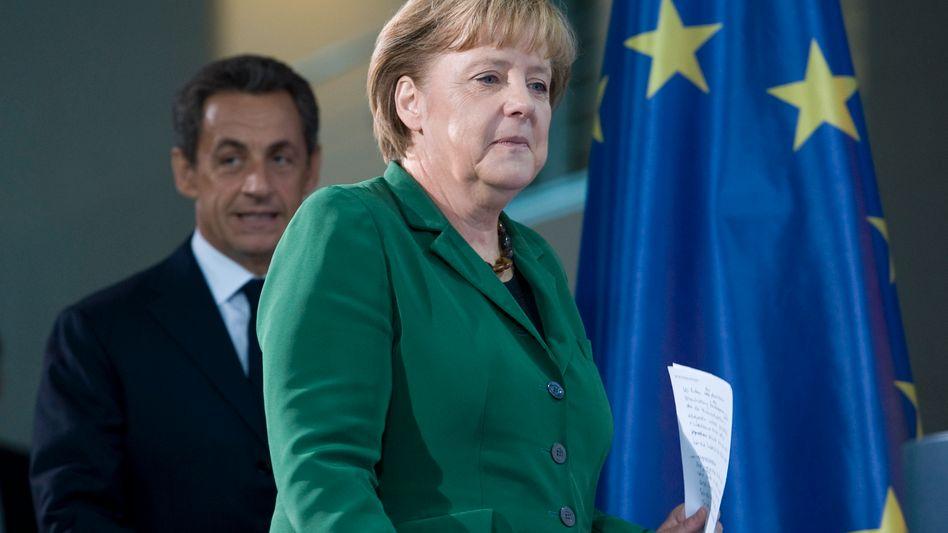 Angela Merkel und Nicolas Sarkozy: Mit dem Hebel gegen die Schuldenkrise