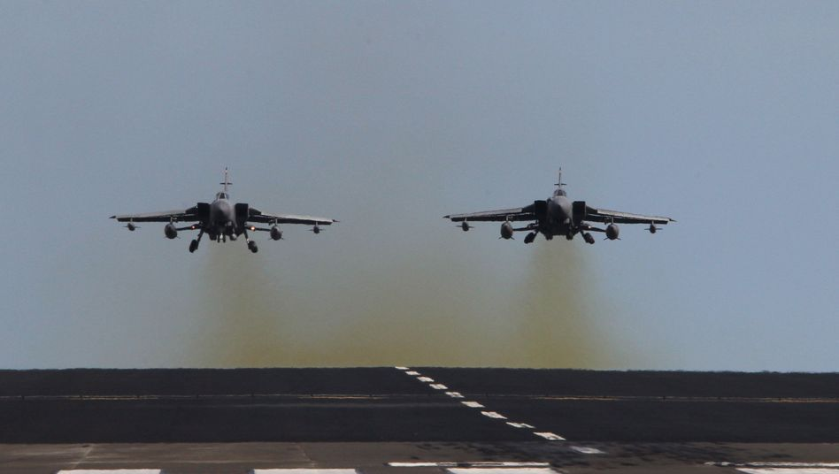 British Tornado aircraft during a training exercise in Scotland on Friday. London is sending aircraft of this type to the Mediterranean to help impose the no-fly zone over Libya.