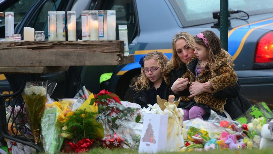 Churchgoers pay their respects to the shooting victims on Sunday in Newtown, Connecticut.