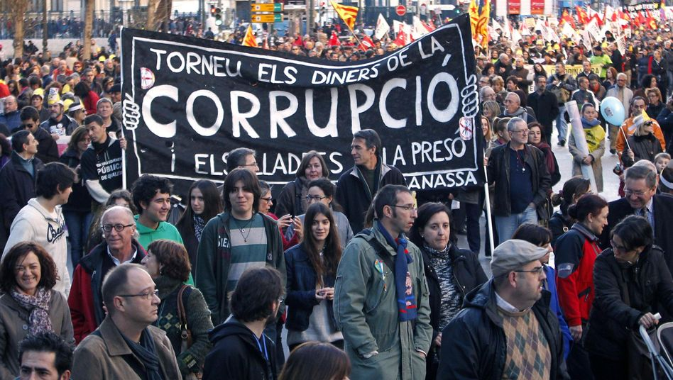 Protesters march during a demonstration against political corruption in Valencia.