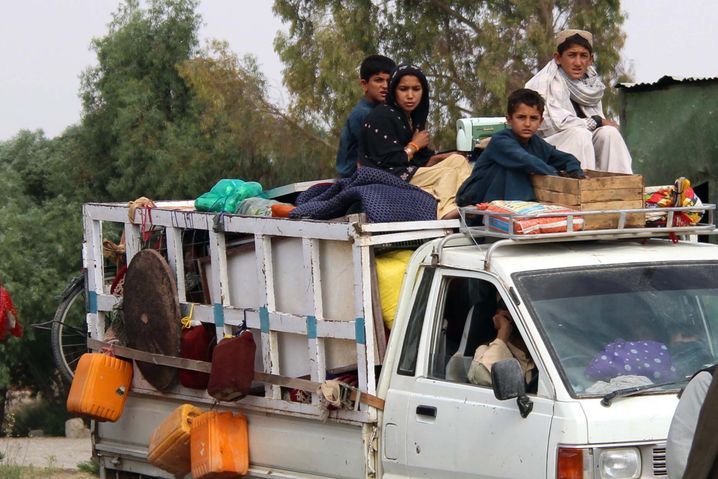 Afghans fleeing attacks in the Helmand Province.