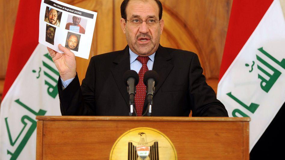 Irakischer Premier Maliki mit Fotos der Getöteten: Abu Wer? Abu Was?