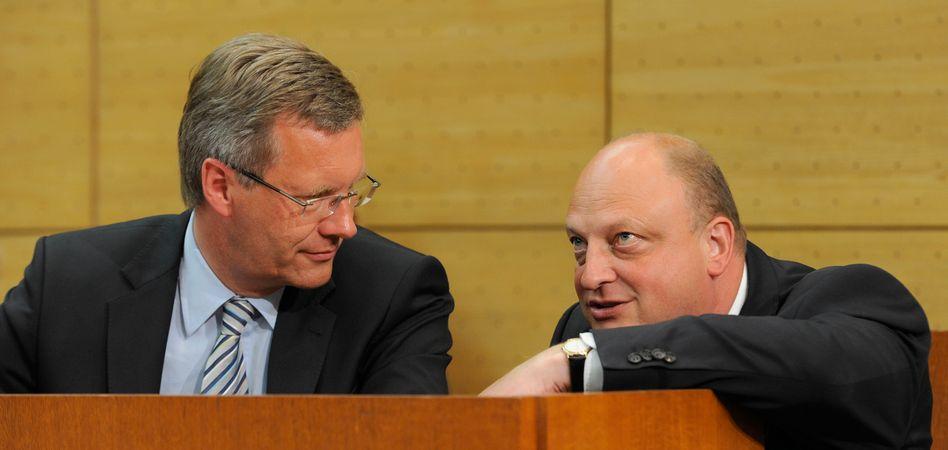 German President Christian Wulff and his former spokesman, Olaf Glaeseker.