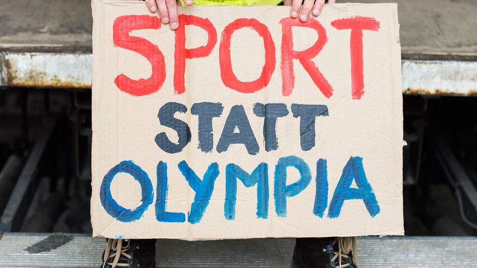 Olympiakritisches Plakat: Kein Text der Gegner im Informationsheft?