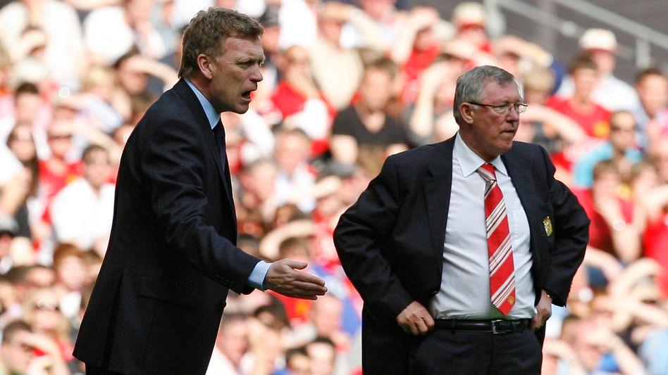 Neuer ManUnited-Coach Moyes (l.), alter Trainer Ferguson: Wachablösung in Manchester