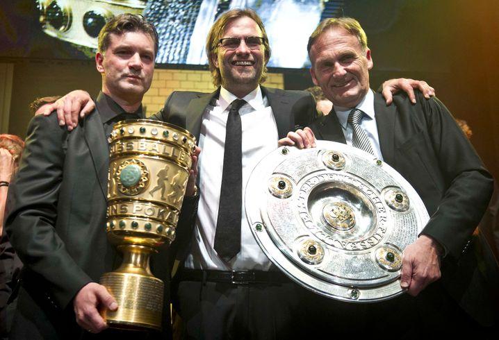 Glückliche Gesichter: Michael Zorc, Jürgen Klopp und Hans-Joachim Watzke (v.l.)