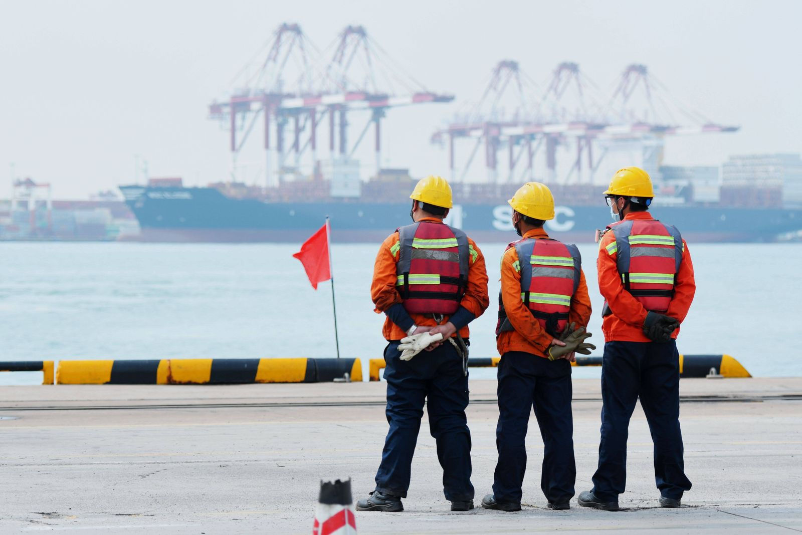 QINGDAO, CHINA - JUNE 02: Dock workers wait for cargo ships at Qingdao Port on June 2, 2020 in Qingdao, Shandong Provin