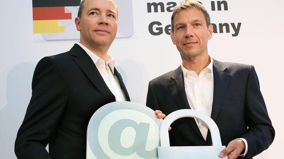 1&1-Gründer Dommermuth und Telekom-Chef Obermann: Werbung für deutsche E-Maildienste