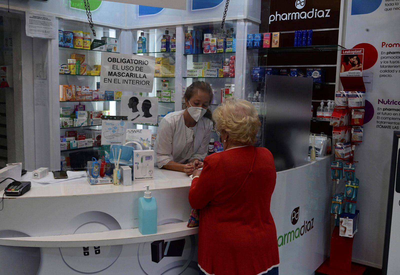 A woman buys her medicines in a pharmacy of Vallecas neirghborhood, in Madrid, Spain on 19 September 2020. Vallecas is o