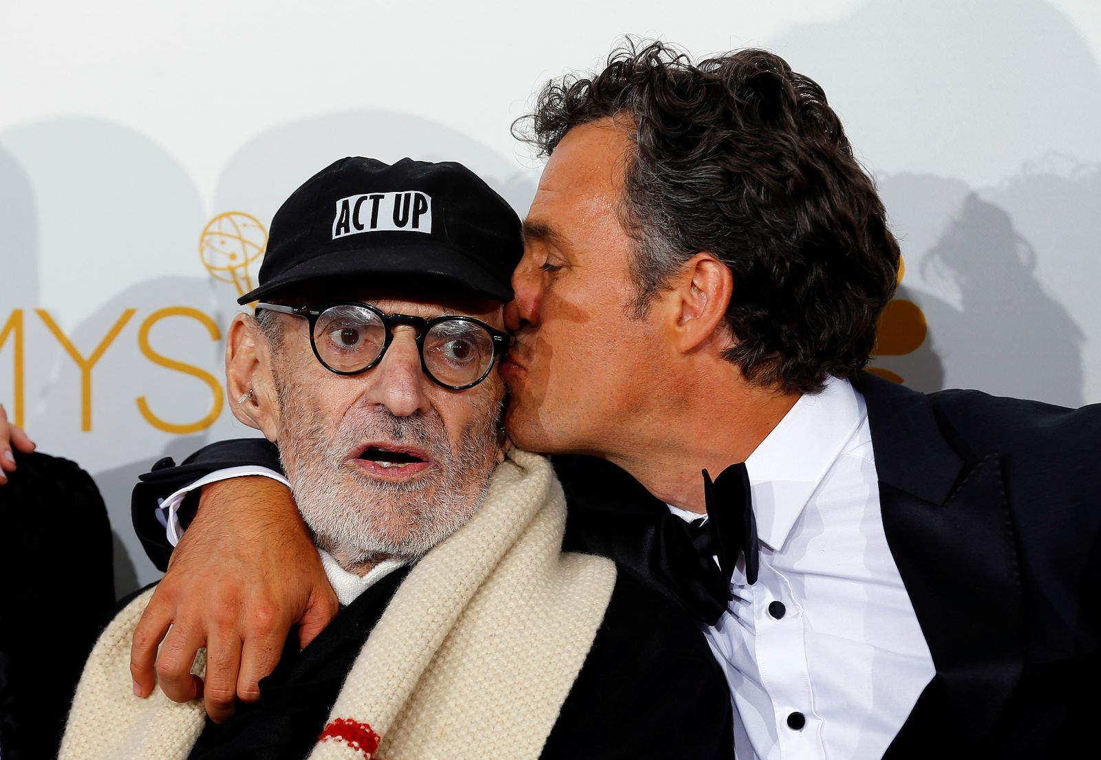 """FILE PHOTO: Larry Kramer and Mark Ruffalo pose backstage after winning the Outstanding Television Movie award for HBO's """"The Normal Heart"""" at the 66th Primetime Emmy Awards in Los Angeles"""