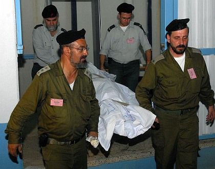 Israeli officers retrieve the body of Gabriel Dawit, returned during the exchange deal between Israel and Hezbollah.