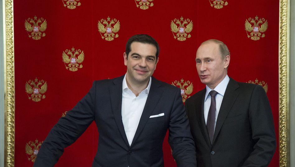 Tsipras (l.) und Putin (im April in Moskau): Über sie wird in Elmau gesprochen
