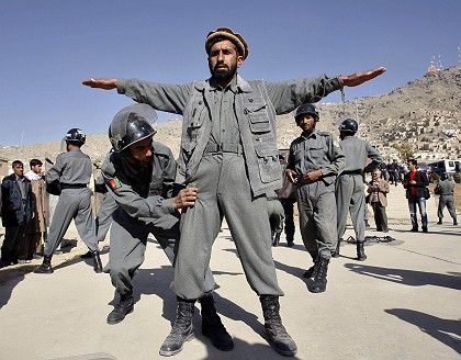 Afghan police stage a demonstration to mark the end of a five-week training course taught by a German team.