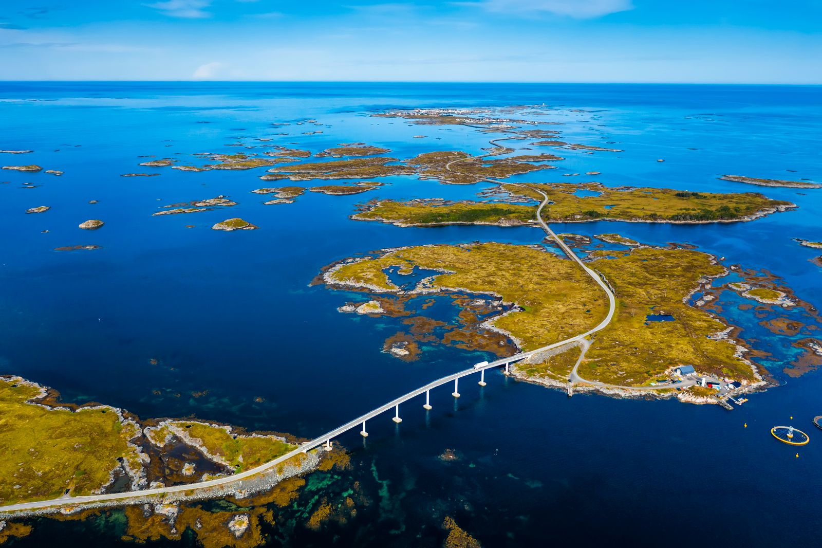 Aerial view of beautiful road with bridge on the island Smola, Norway.