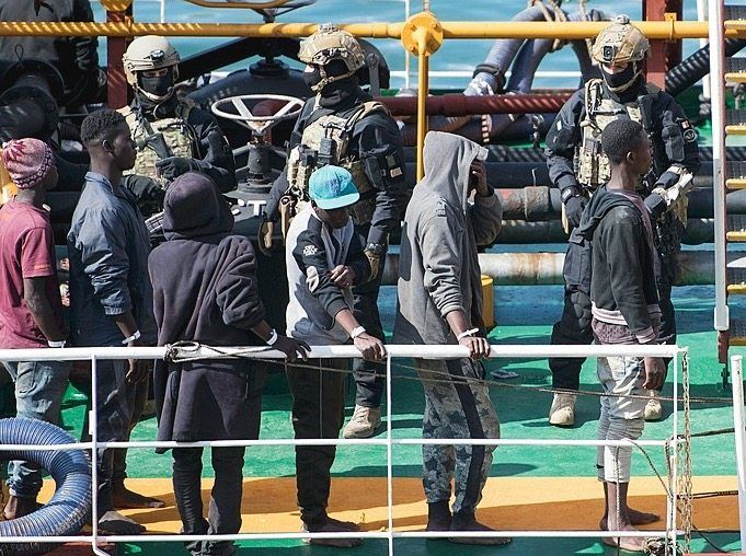 Migrants and security personnel onboard the El Hiblu 1.