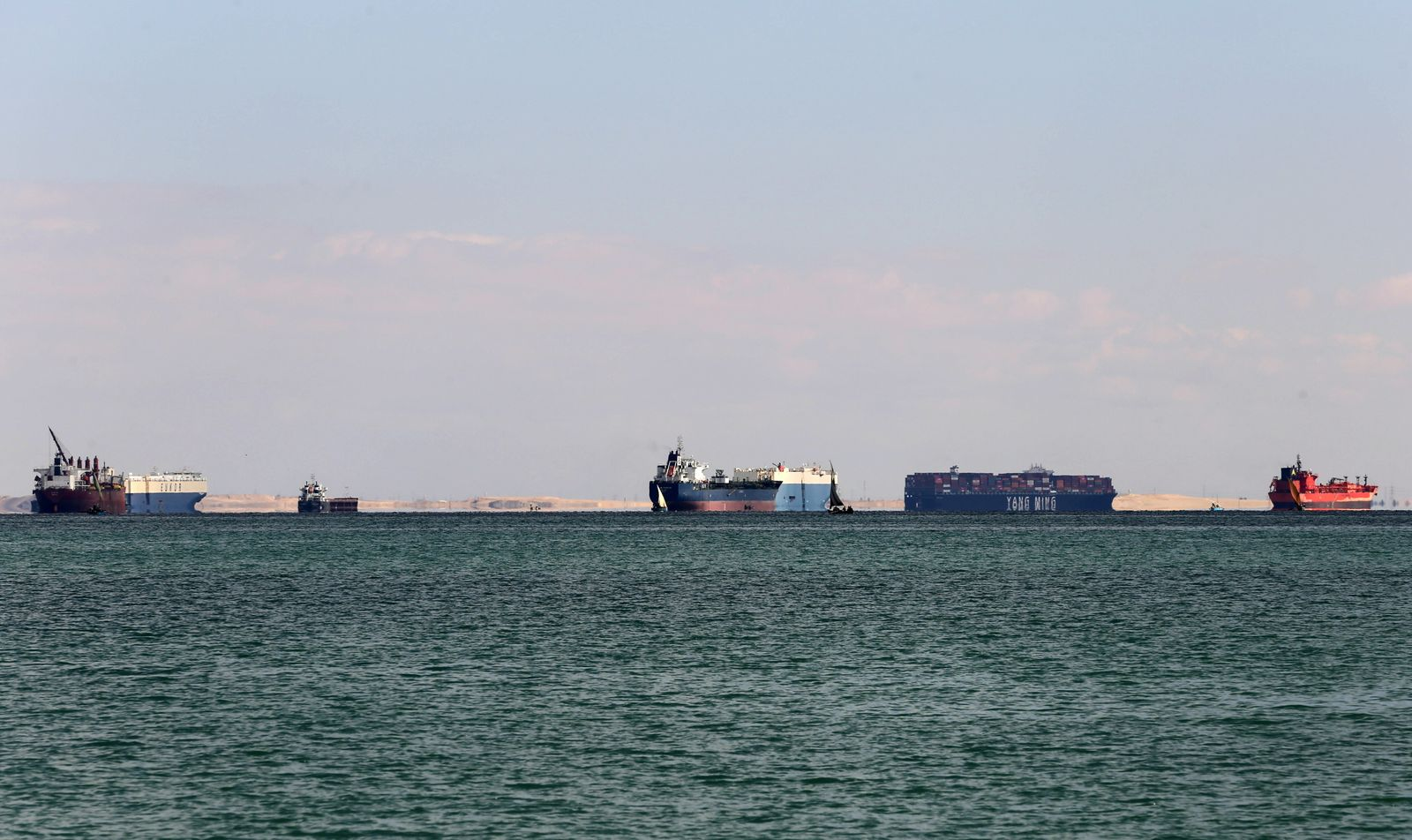Ships are anchored outside the Suez Canal, near Ismailia
