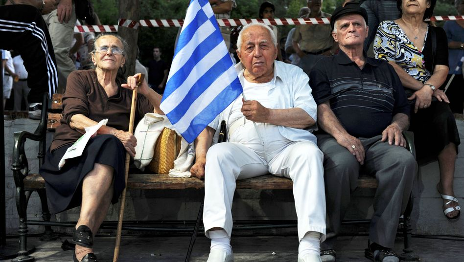 Elderly Greeks at a political rally: Are older people partly to blame for Europe's debt crisis?
