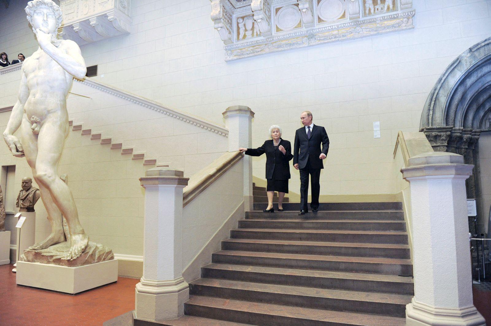Russia's Prime Minister Putin, accompanied by Director of the Pushkin Museum of Fine Arts Irina Antonova, visits an exhibition of Italian artist Michelangelo De Caravaggio in Moscow