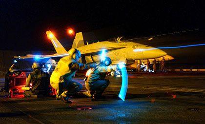 US-Kampfjet auf Flugzeugträger: Symbol für amerikanisches Hegemoniestreben