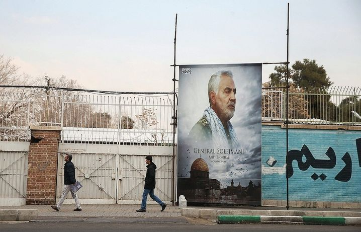 """A poster of Qassem Soleimani in front of the former U.S. Embassy in Tehran. One intellectual called his death a """"a symbol of Iran's loss of power in the Middle East."""""""
