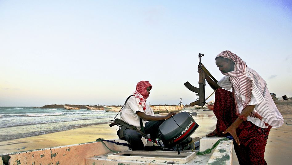 Somali pirates prepare to conduct an attack in Hobyo in northeastern Somalia in this 2010 archive photo.