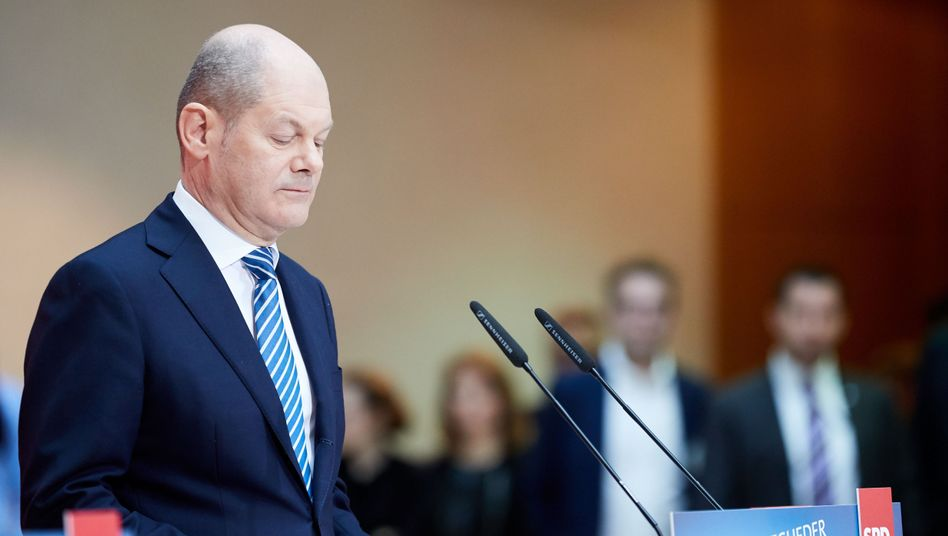 Vice Chancellor-designate Olaf Scholz announcing the results of the SPD membership vote on the new coalition with Chancellor Angela Merkel on Sunday.