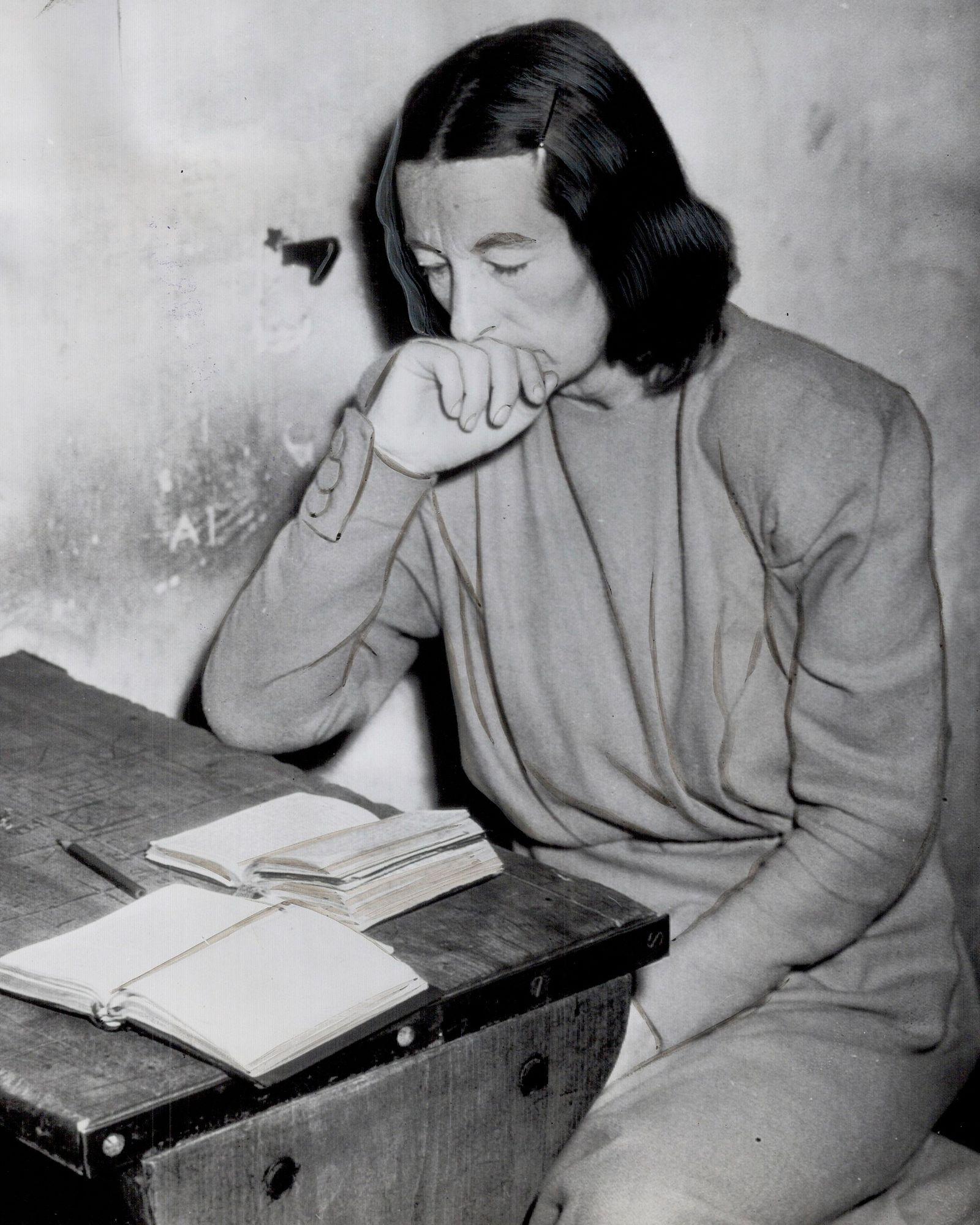 Awaiting trail; like Frau Von Schirach; is Mrs. Hans Frank; reading Bible in cell at Miesbach; Germa