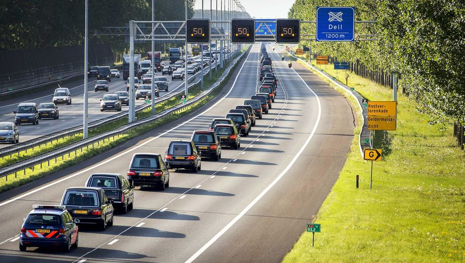 A column of hearses leaves an airbase in Eindhoven, The Netherlands, carrying the bodies of victims of the Malaysia Airlines crash.