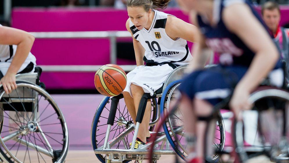 Behindertensportler: Arbeiten, um Gold zu holen