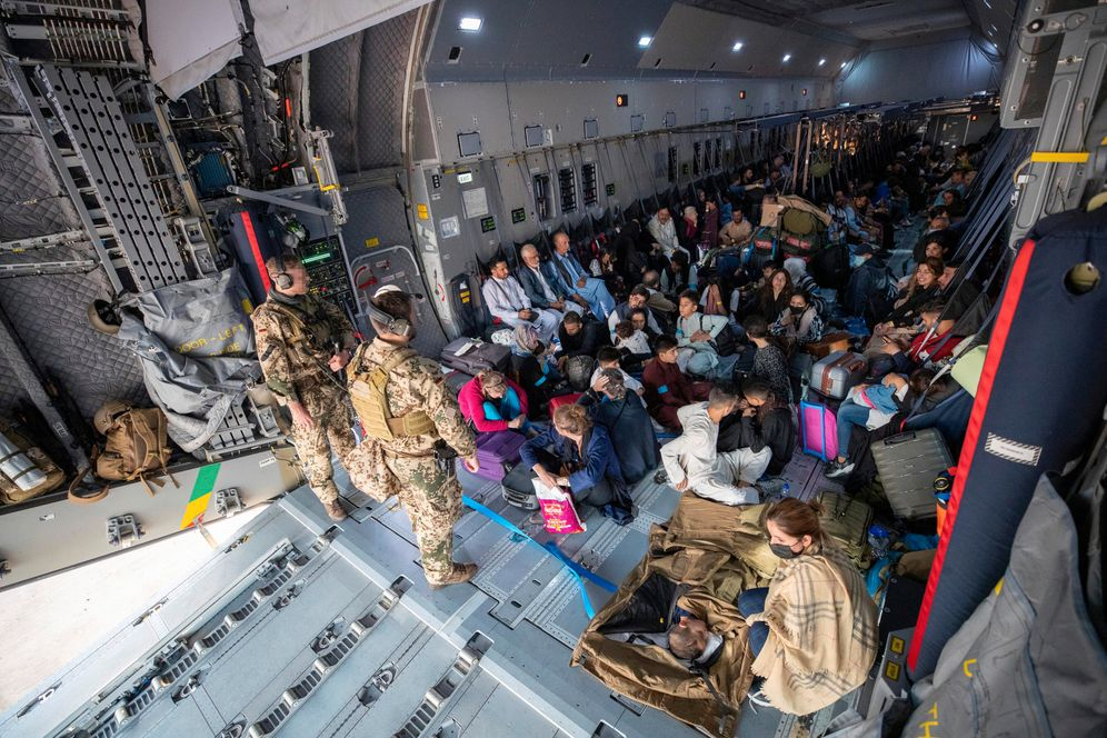 A Bundeswehr Airbus A400M on August 17: Evacuees wait to leave the aircraft after landing in Tashkent from Kabul.
