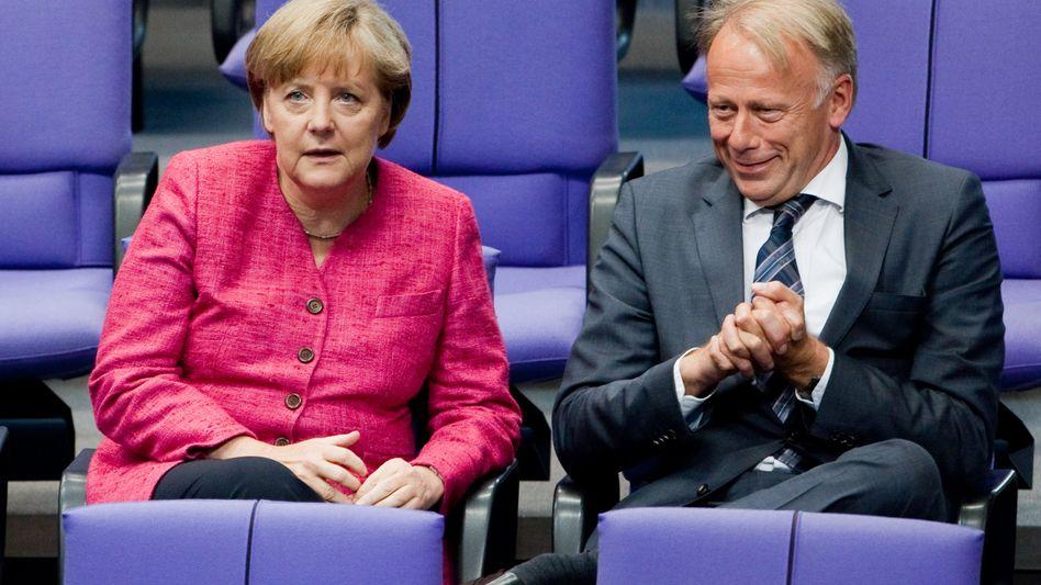 Merkel, Trittin (im Juni 2011 im Bundestag): Kein Plan, aber auch kein echtes Problem