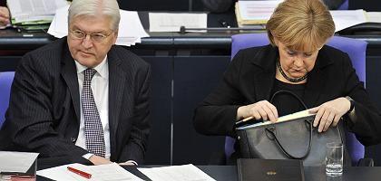 SPD-Kanzlerkandidat Steinmeier, Regierungschefin Merkel (CDU): CDU-Wirtschaftsrat fordert klarere Abgrenzung