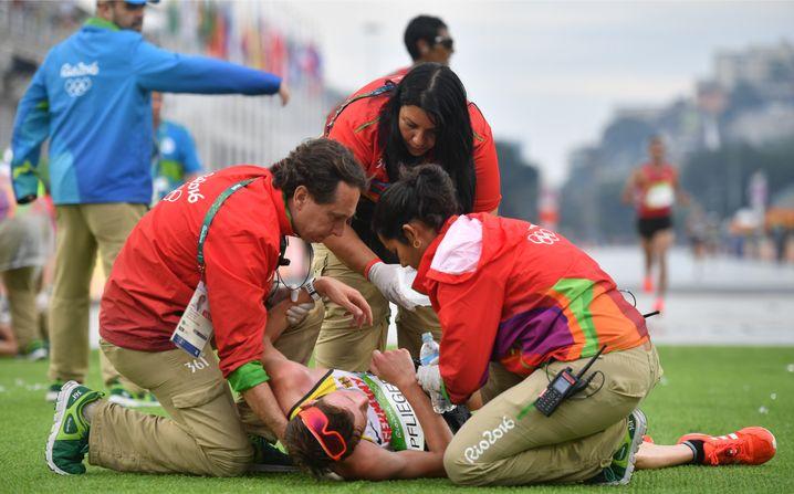 Olympia in Rio 2016: Die heißen Temperaturen machen Pflieger zu schaffen - er erreicht das Ziel als bester deutscher Läufer in 2:18:56 Stunden