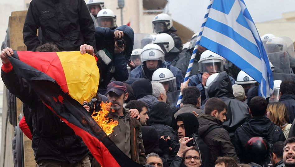 A protester burns a flag of Germany during a protest in Athens: Making enemies with an entire people