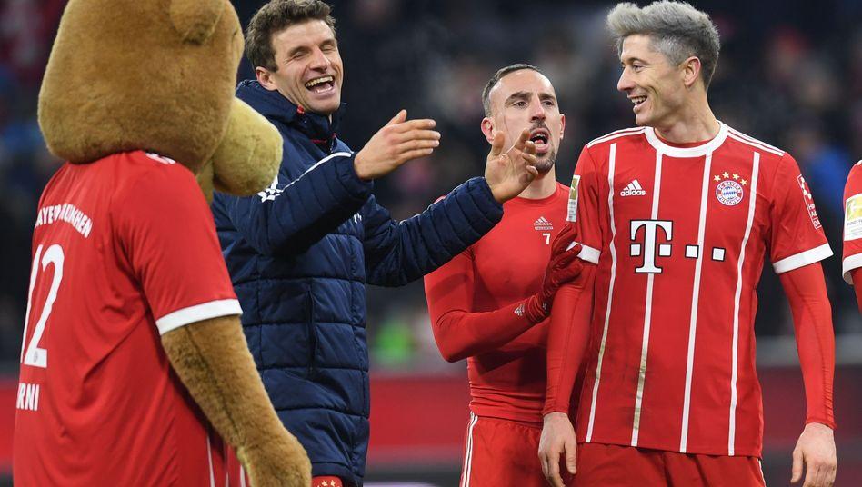 Thomas Müller, Franck Ribéry und Robert Lewandowski (von links)