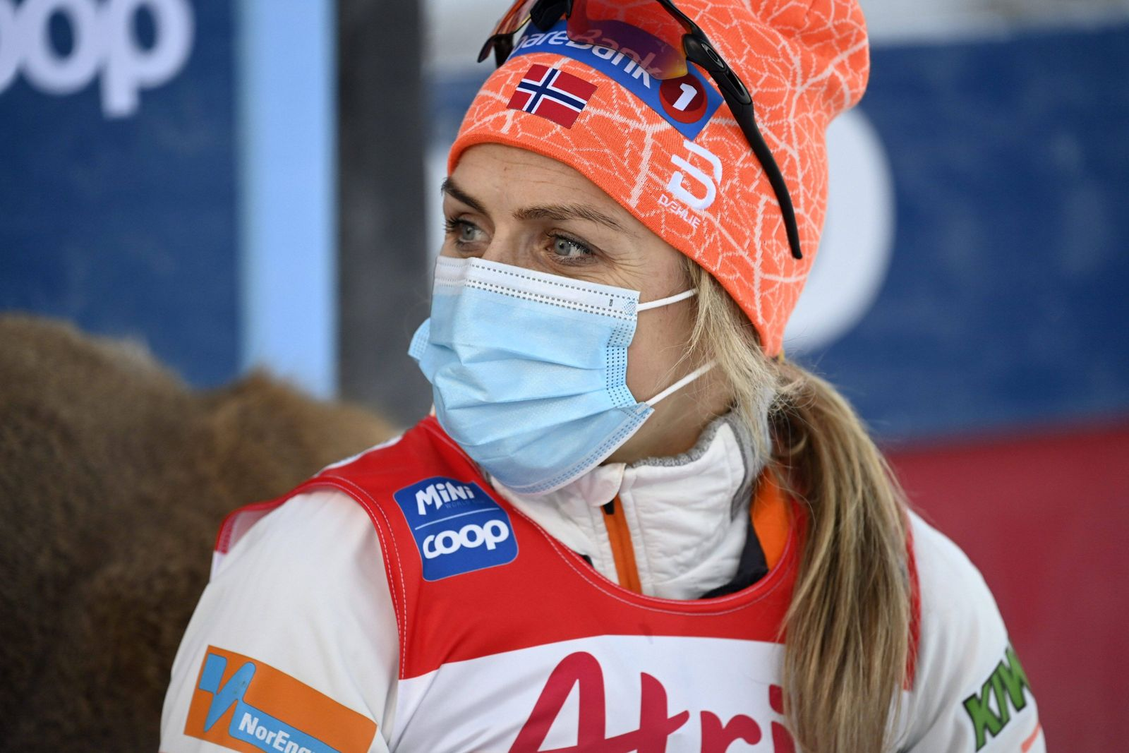 Therese Johaug of Norway wears protective face mask after finishing women s cross country skiing classic style 10 km co