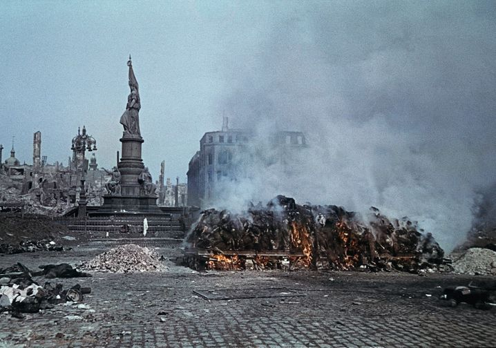 A pile of burning corpses on Dresden's Altmarkt Square in February 1945.
