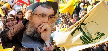 """Celebrating the """"Day of Resistance"""" in Beirut: A woman holds aloft a photograph of Hezbollah leader Hassan Nasrallah."""