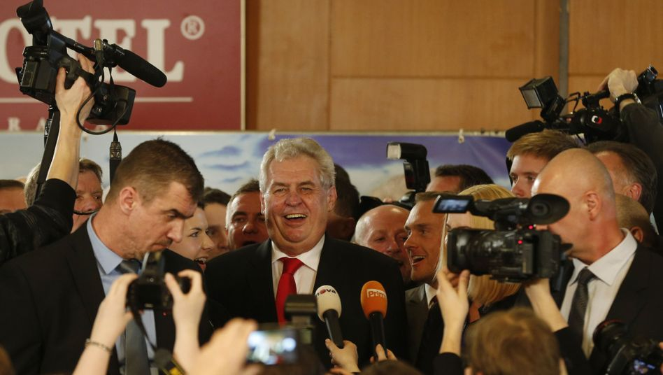 Milos Zeman smiles while addressing the media after the announcement of his victory.