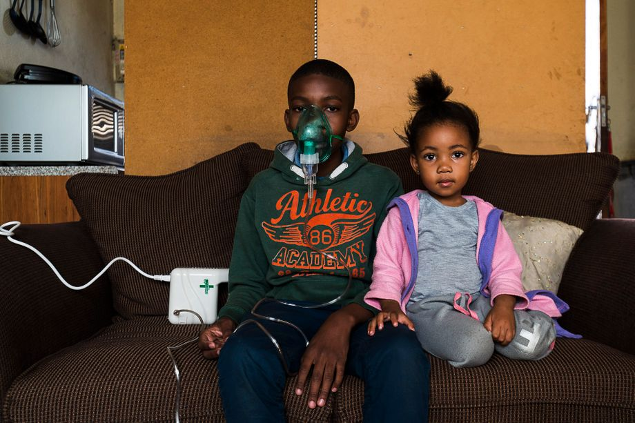 Shaun, 13, contracted bronchitis due to air pollution. He has to use an inhaler to breathe.