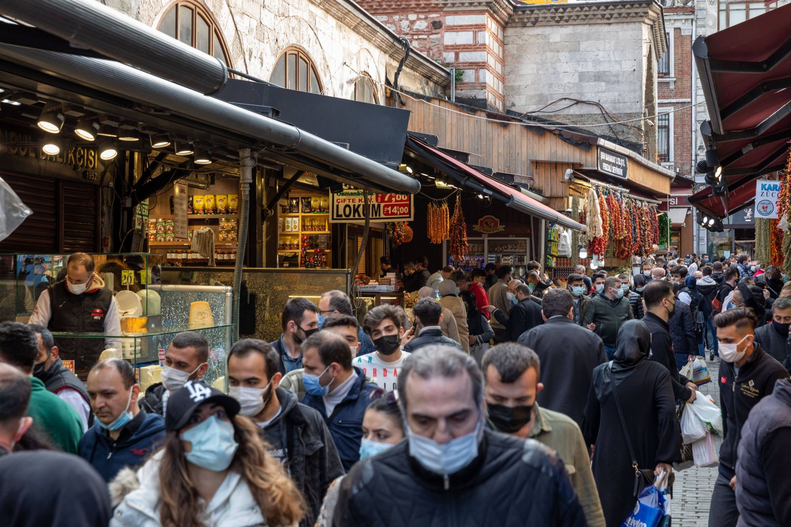April 15, 2021: People shopping in Eminonu before the curfew on the 3rd day of Ramadan in Istanbul,Turkey, April 15, 202
