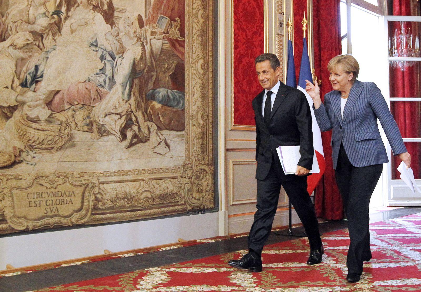 Merkel, Sarkozy call for new eurozone budget rules