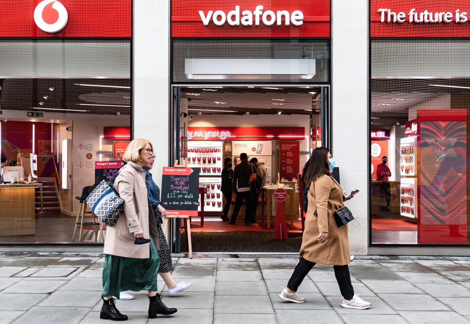 May 17, 2021, London, United Kingdom: People passing Vodafone telecom shop. The Prime Minister announced that England c