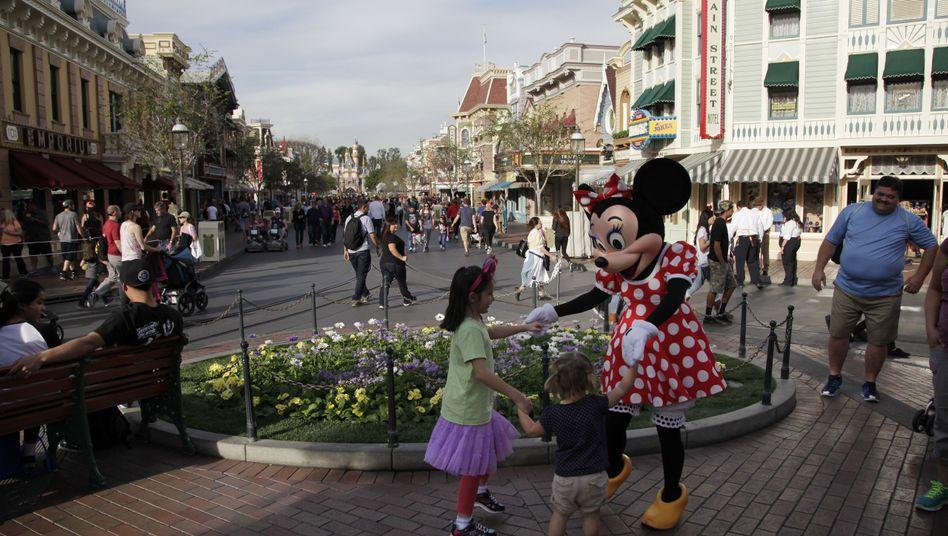 Minni Mouse und Kinder im Disneyland Kalifornien: Quelle der Ansteckung