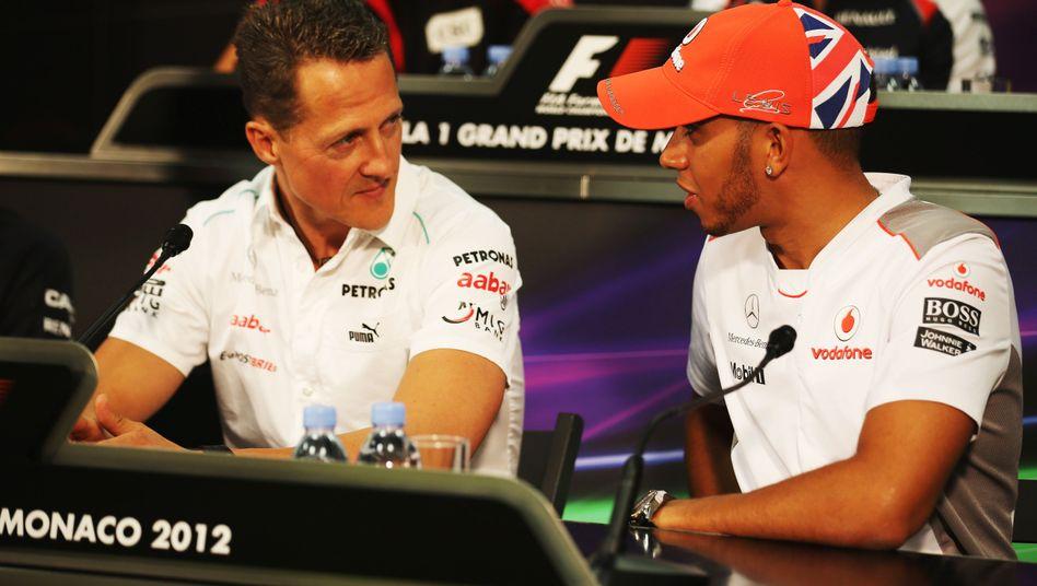 Lewis Hamilton (r.) mit Michael Schumacher (Archivbild)