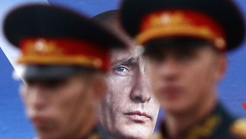 A poster of Russian Prime Minister Vladimir Putin, a former KGB spy.