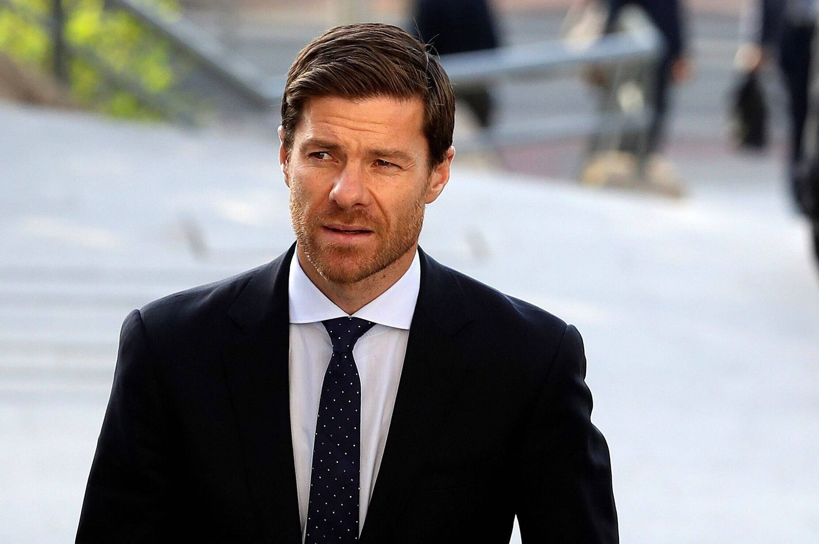 Former professional soccer player Xabi Alonso (C) arrives to Audiencia Nacional court to attend his trial for several a