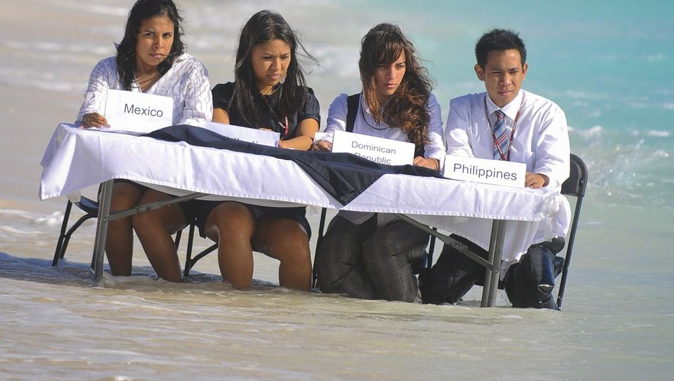 Activists protest at a beach in Cancun on the sidelines of the UN Climate Change Summit.